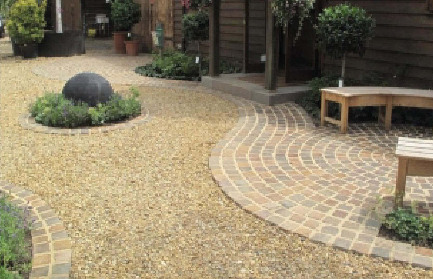 Revolutionise your garden with Gravel. Theis cost-effective feature is effective in all weather conditions and allows for the perfect setting of medditearean-style plants such as Lavender, Santolina and Rosemary.